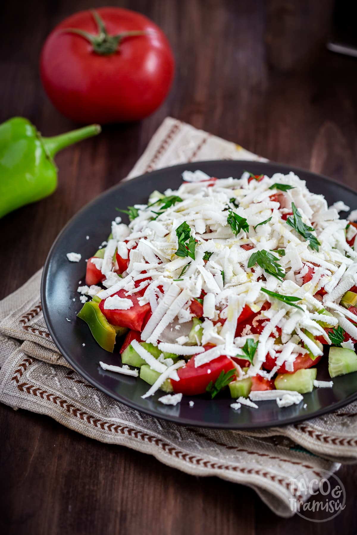 shopska salad with a tomato and pepper aside
