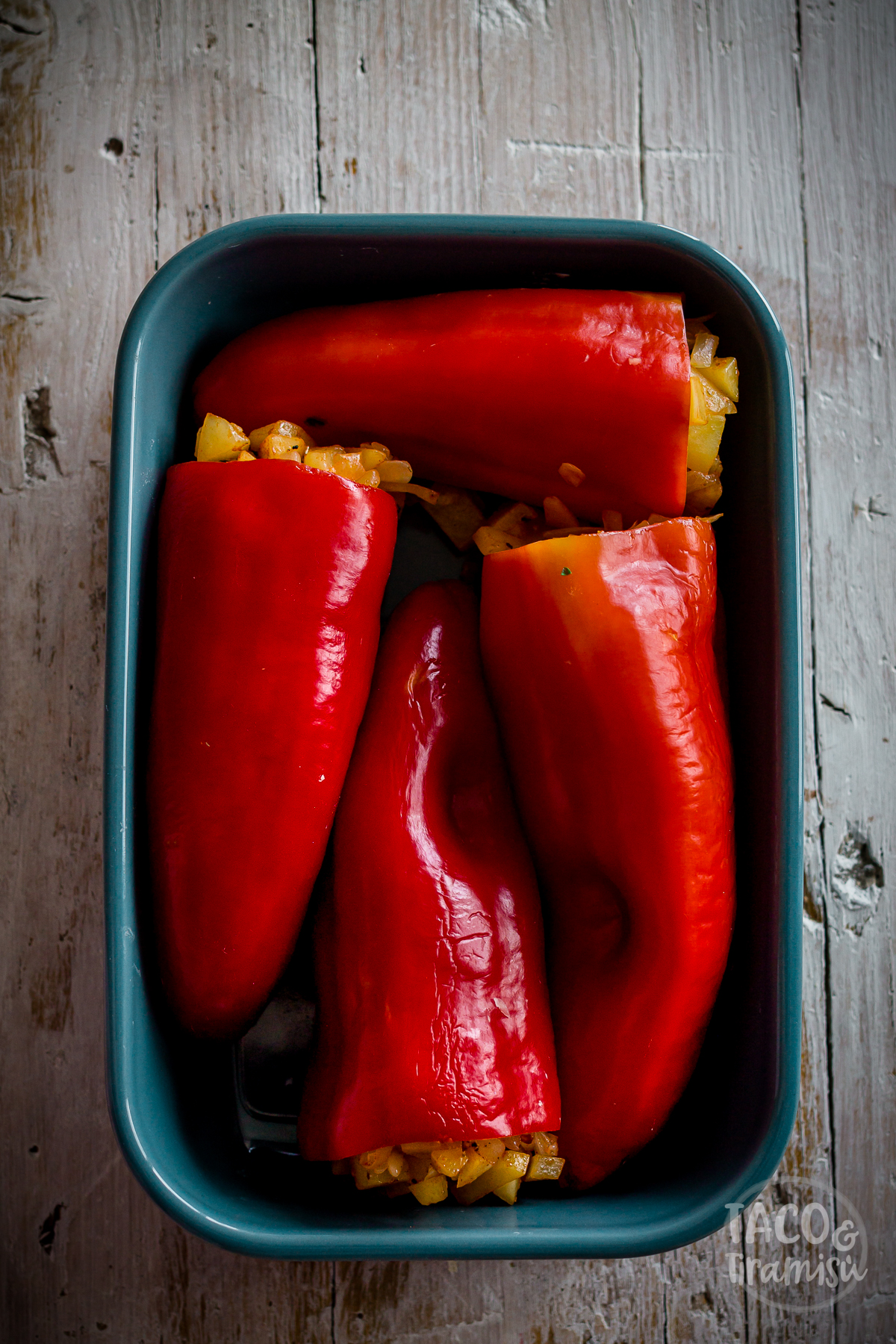 stuffed peppers in a pan for baking