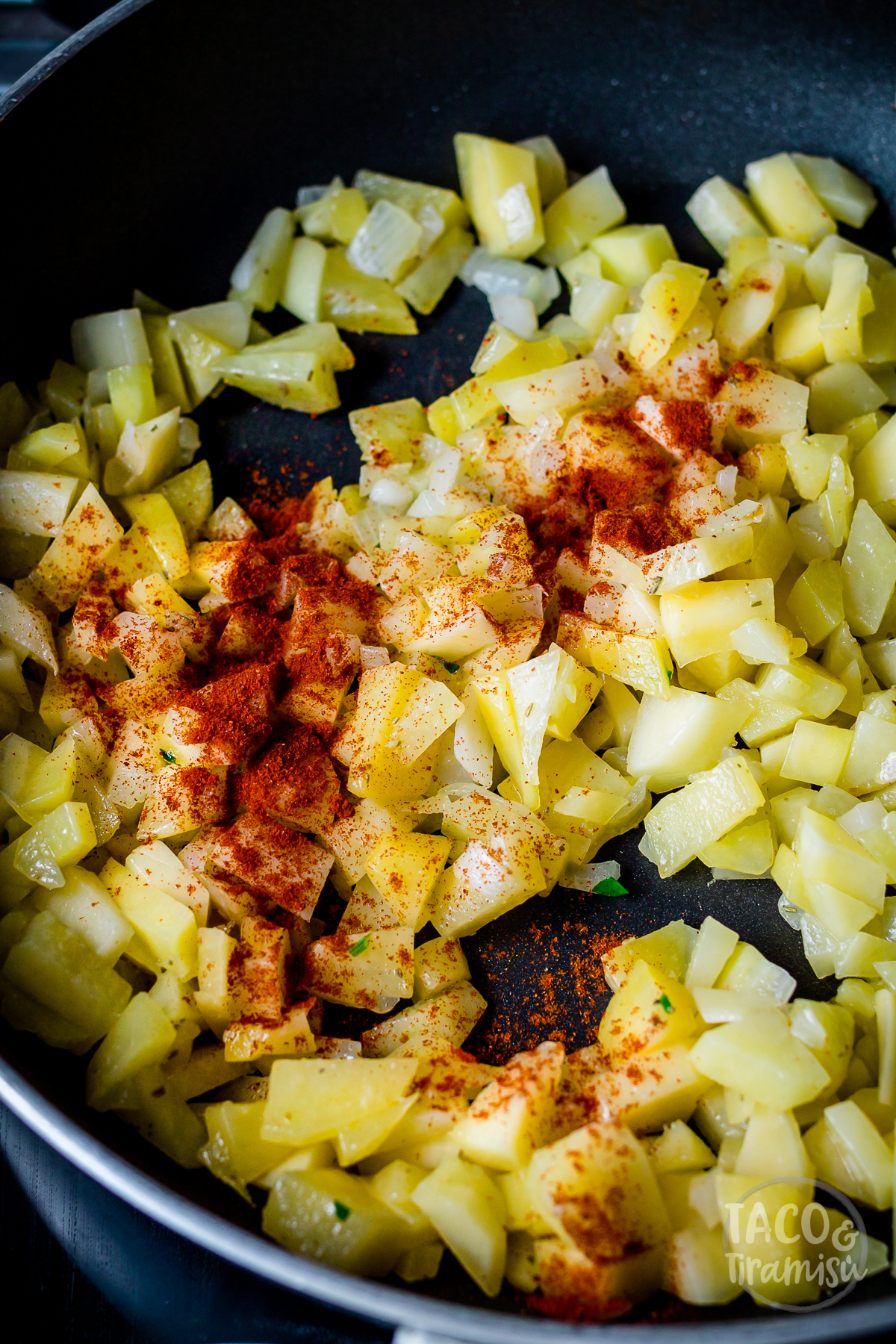diced potatoes cooked on a pan with red pepper
