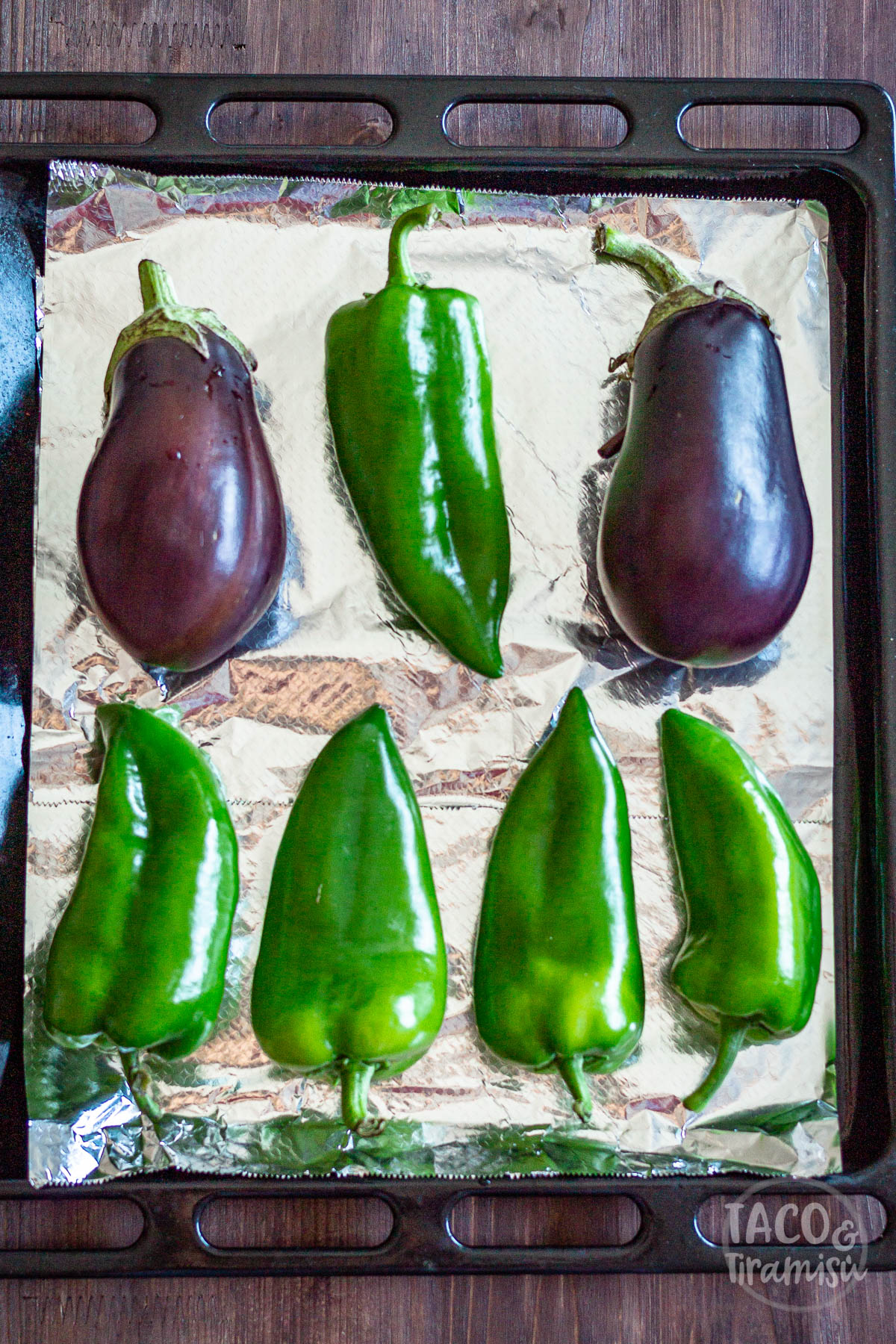 peppers and eggplants on a tin with aluminium oil