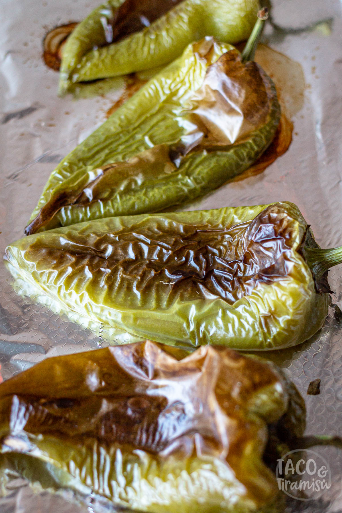 baked peppers on a tin with aluminium foil