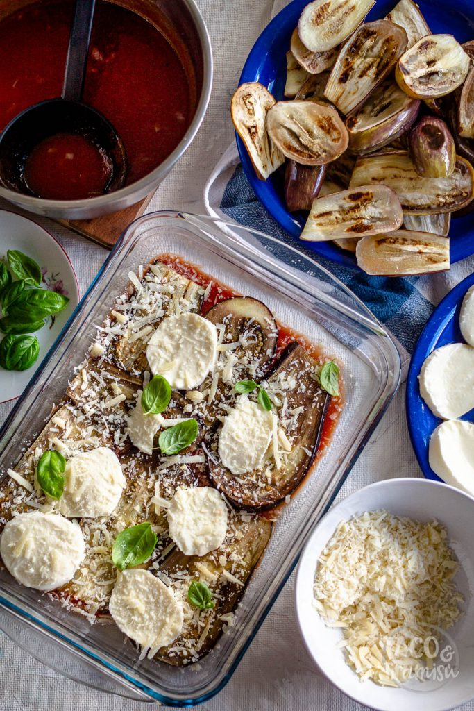 layering parmigiana with ingredients
