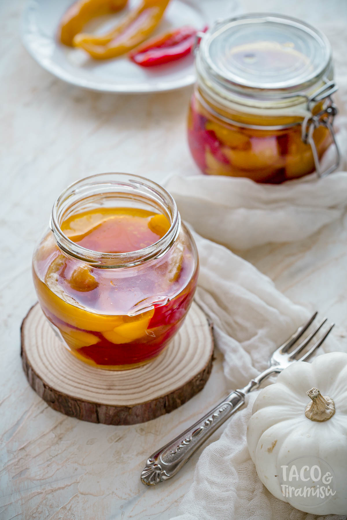 marinated bell peppers in two jars, one open