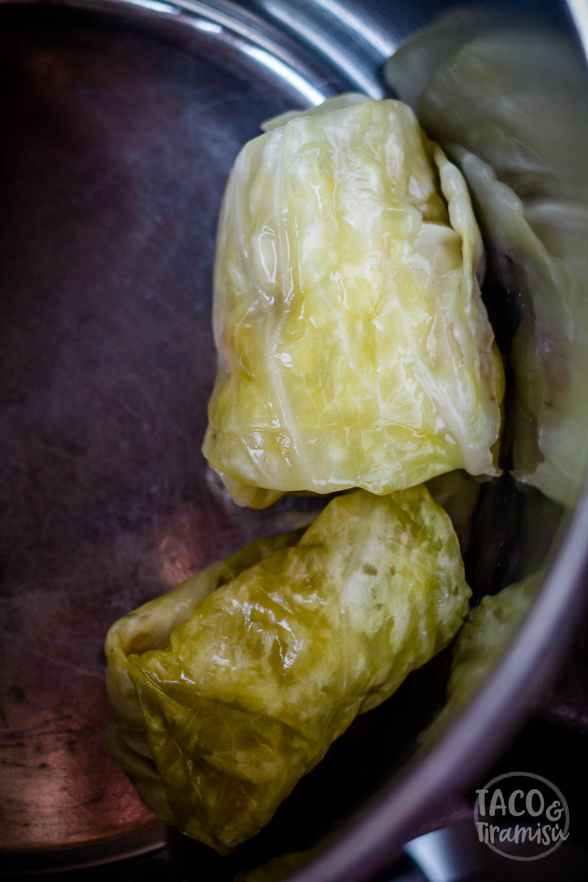 arranging the cabbage rolls in a pan