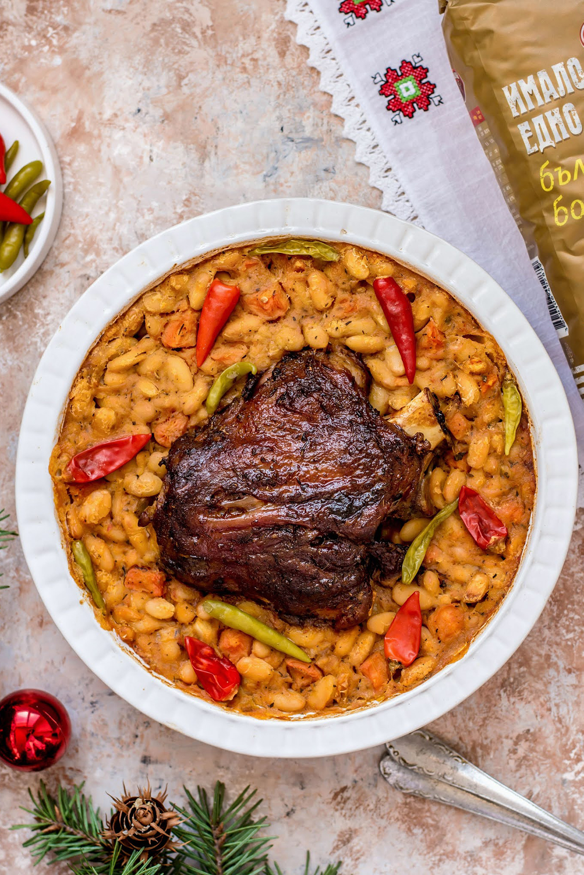 baked beans with pork shank in a baking dish