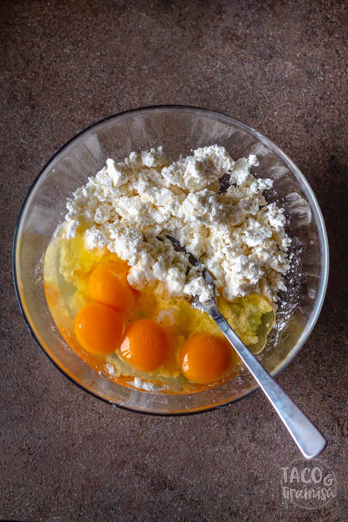 crumbled cheese and eggs in a bowl