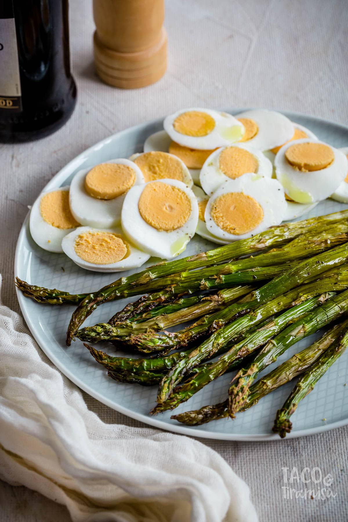 roasted asparagus and eggs on a plate, close up photo